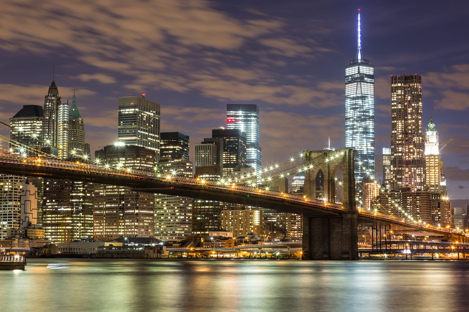 Brooklyn Bridge and Downtown Skyscrapers in New York at Night