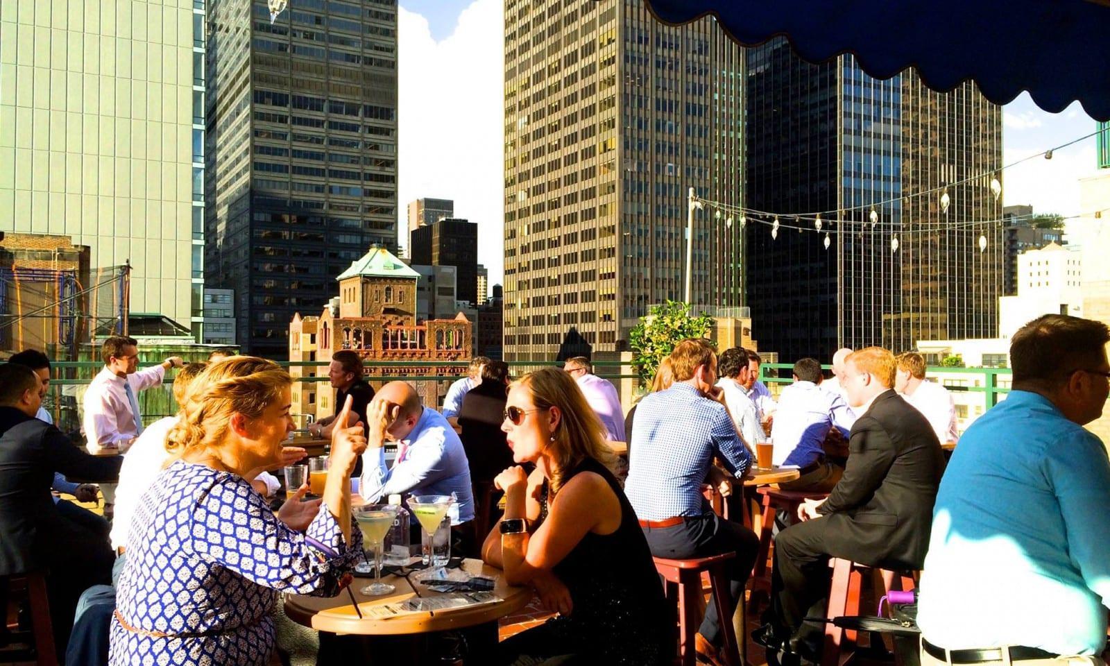 visitors at the rooftop bar rare view