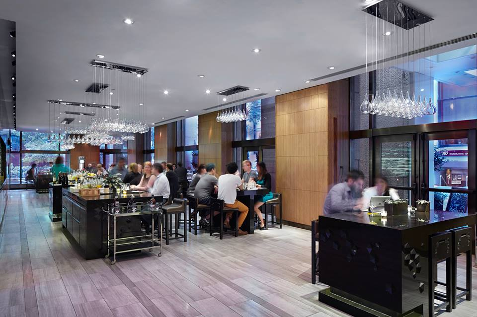hotel guests at tables at andaz wall street hotel new york
