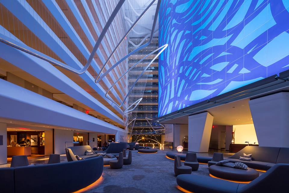 blue-lit hote lobby at the conrad hotel new york
