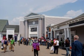 people standing in fron of the woodbury outlet