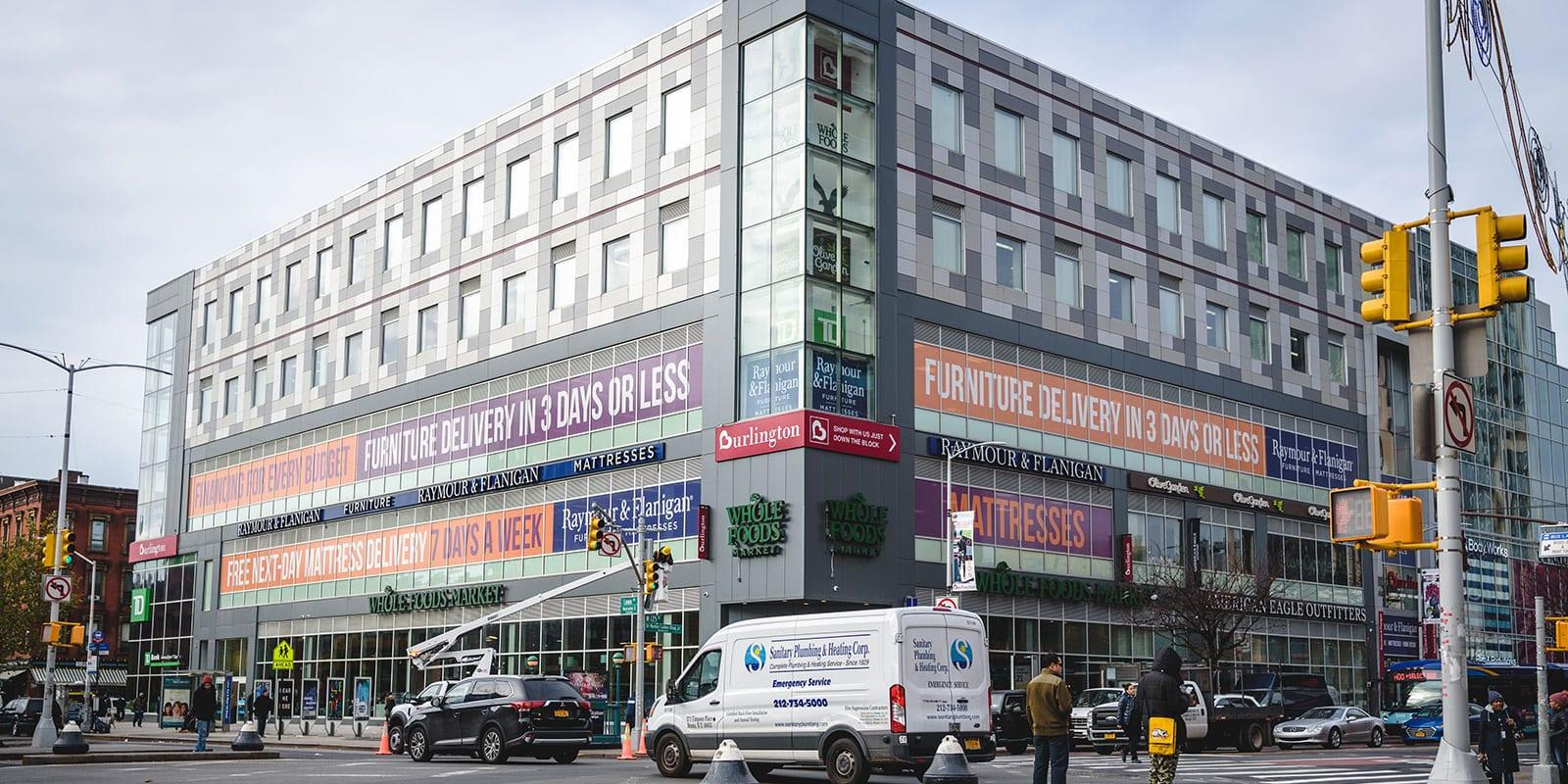A small shopping center being built in Harlem