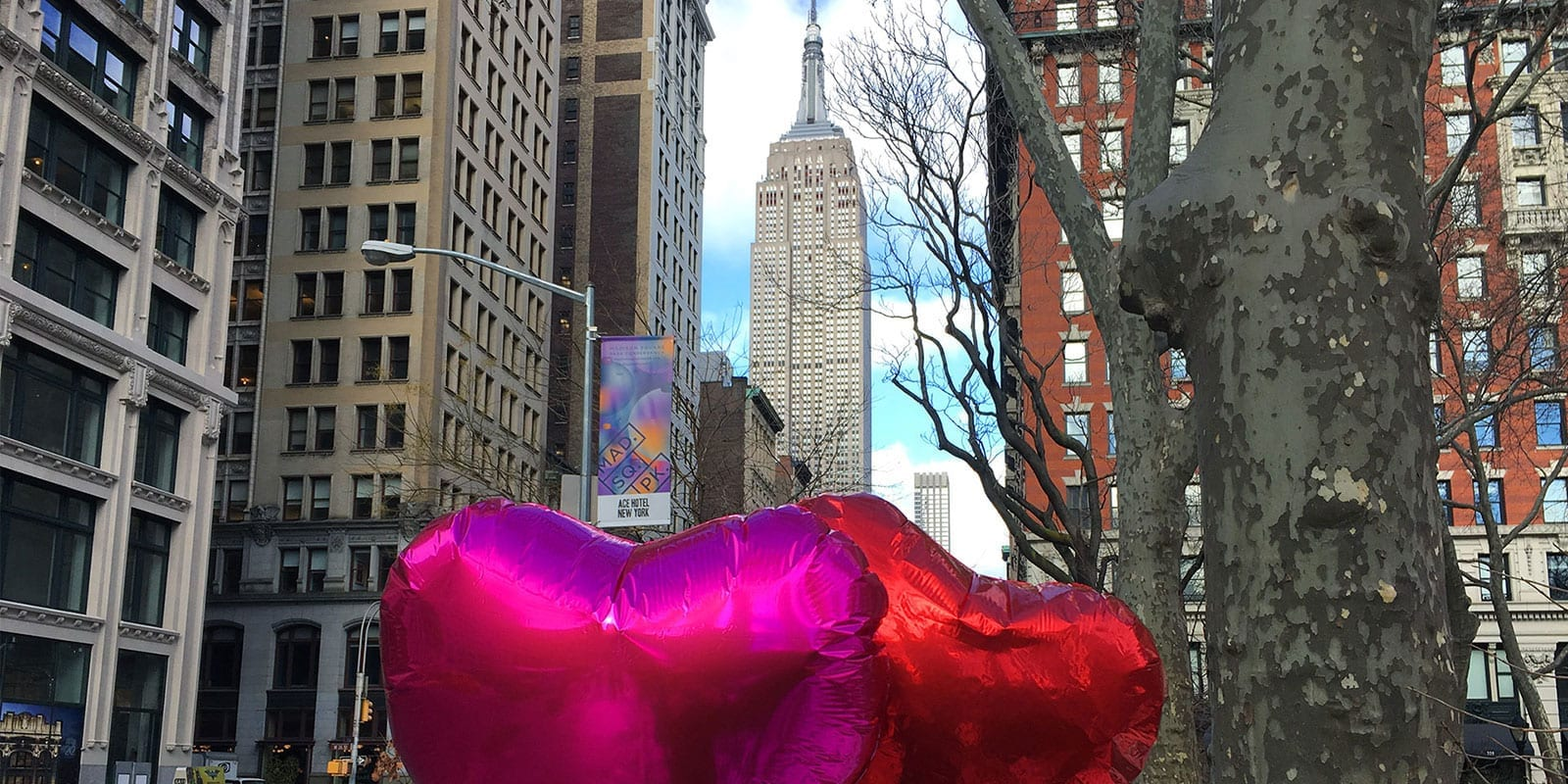 Empire State Building with Heart Balloons
